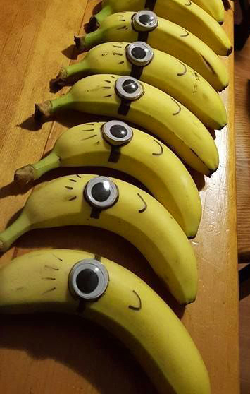 Bananas with Minion faces drawn on them- Non-candy Halloween treats - Adventures in NanaLand
