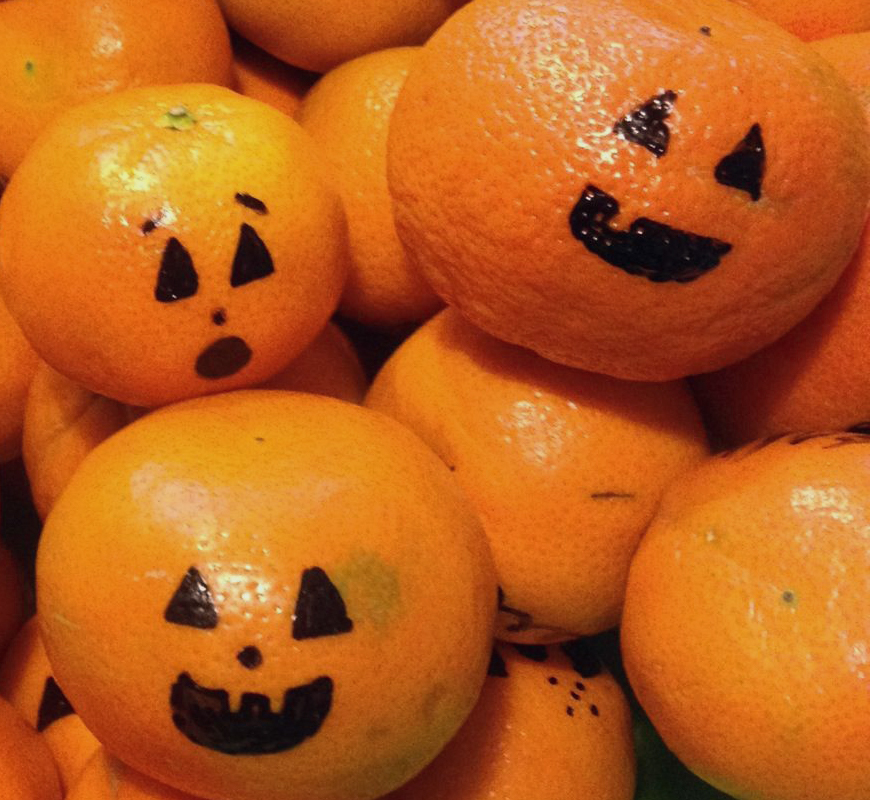 Mandarin oranges with pumpkin faces drawn on them - Non-candy Halloween treats - Adventures in NanaLand
