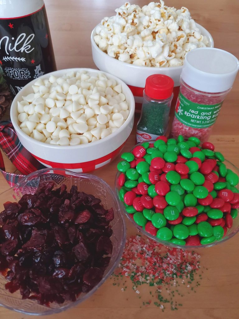 Ingredients for Snowy White Popcorn (popcorn, vanilla chips, M&Ms, red and green sprinkles) - Snowy White Popcorn - Adventures in NanaLand