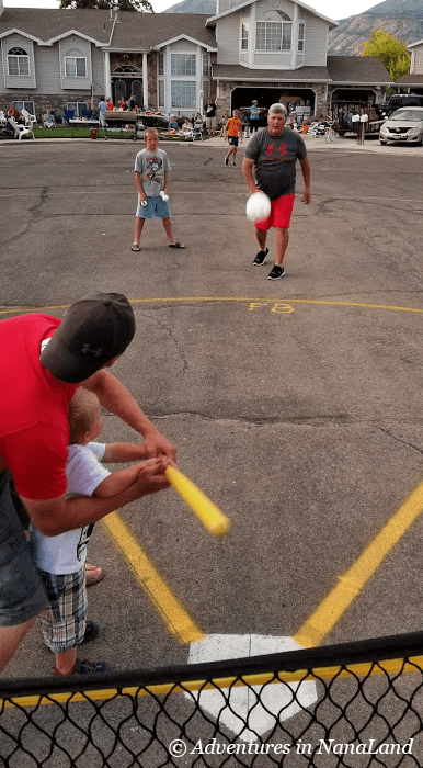 Kids playing Wiffle ball with grandparents - Grandma Camp Weekend - Adventures in NanaLand