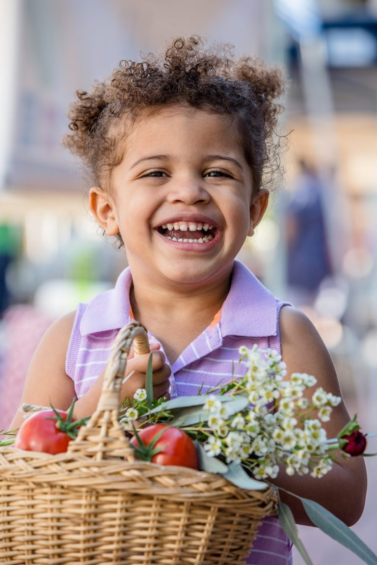 Cute girl at farmers market - farmers market with grandkids - Adventures in NanaLand