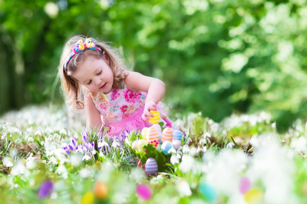 Girl playing with Easter basket - Finding Christ - Adventures in NanaLand