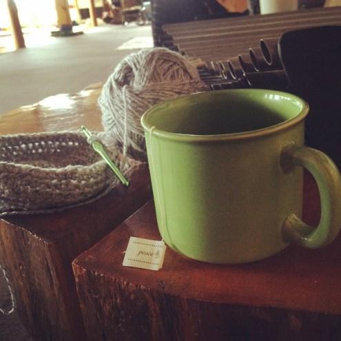 cup of tea & yarn on my needle