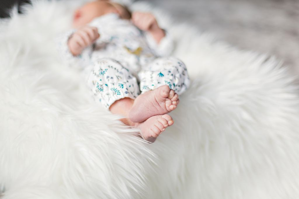 newborn baby on fluffy rug