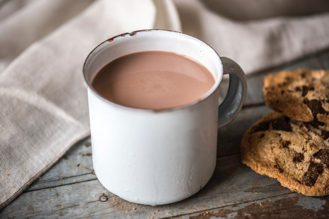 mug of hot chocolate with cookies at the side