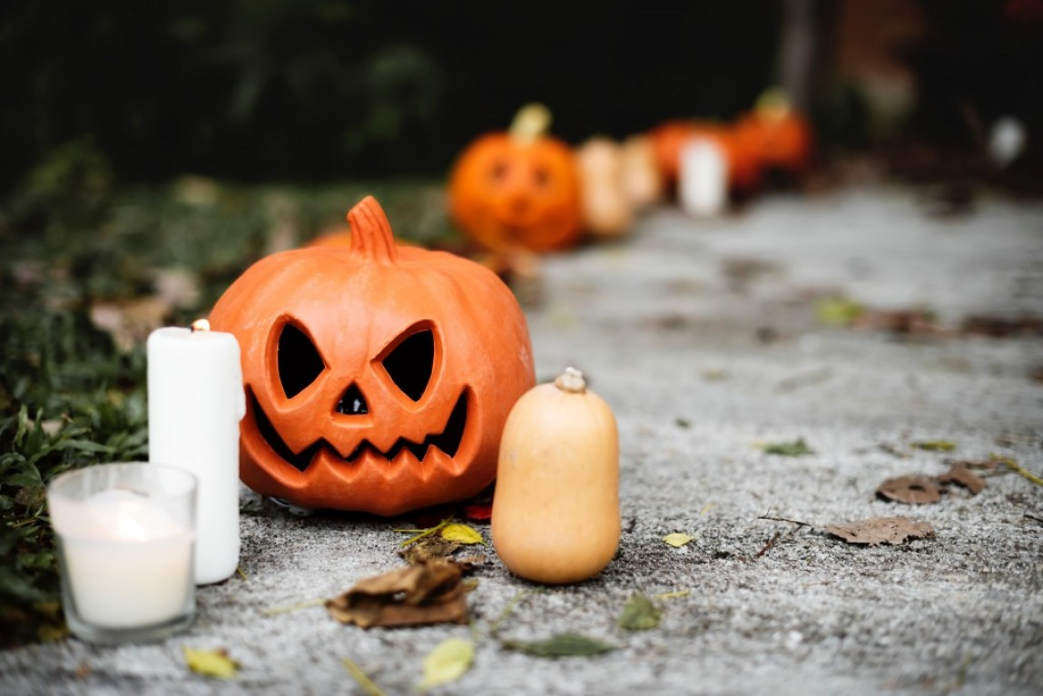 carved pumpkin and white candles