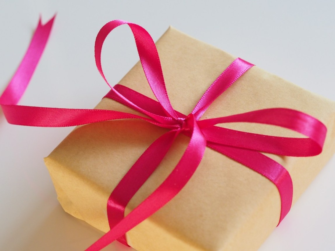 small wrapped gift with pink bow