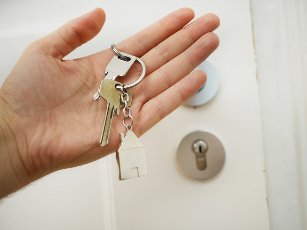 hand holding house keys with keyring