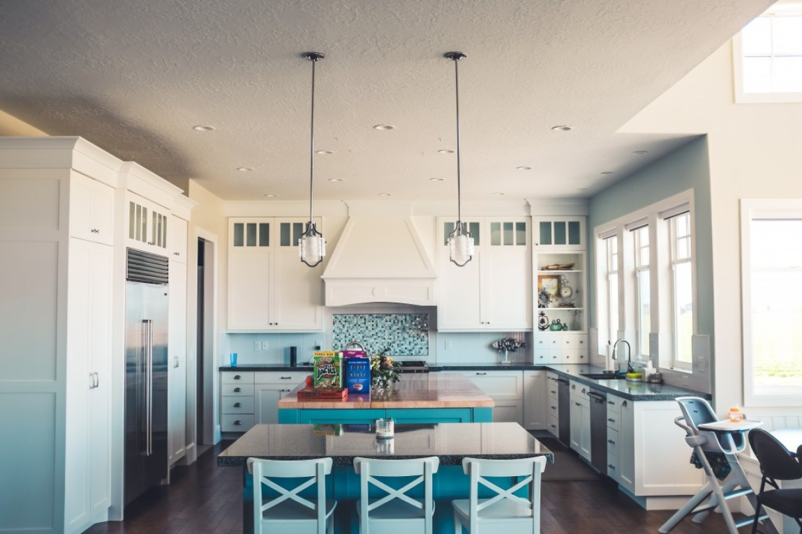 modern family kitchen with teal color features