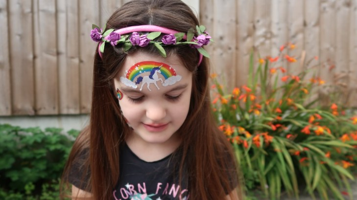 girl with flowers in hair wearing fablab temporary face tattoo