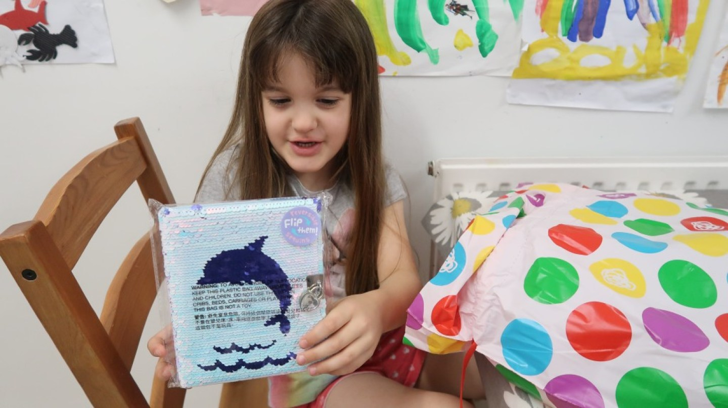 girl holding sequin pencil case from smiggle