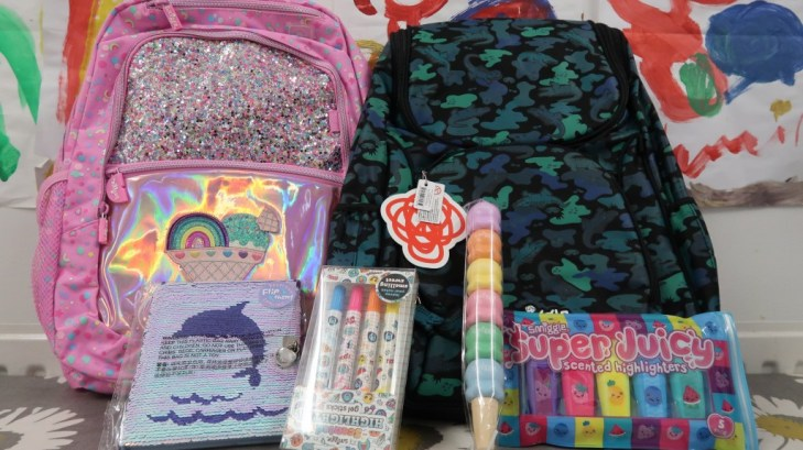 pink and blue smiggle back packs with smiggle products in foreground