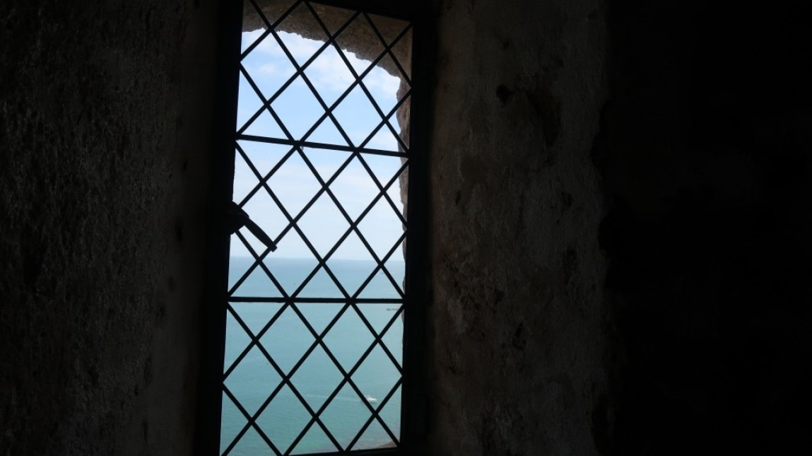 window looking out to sea Mont Orgueil Castle Jersey