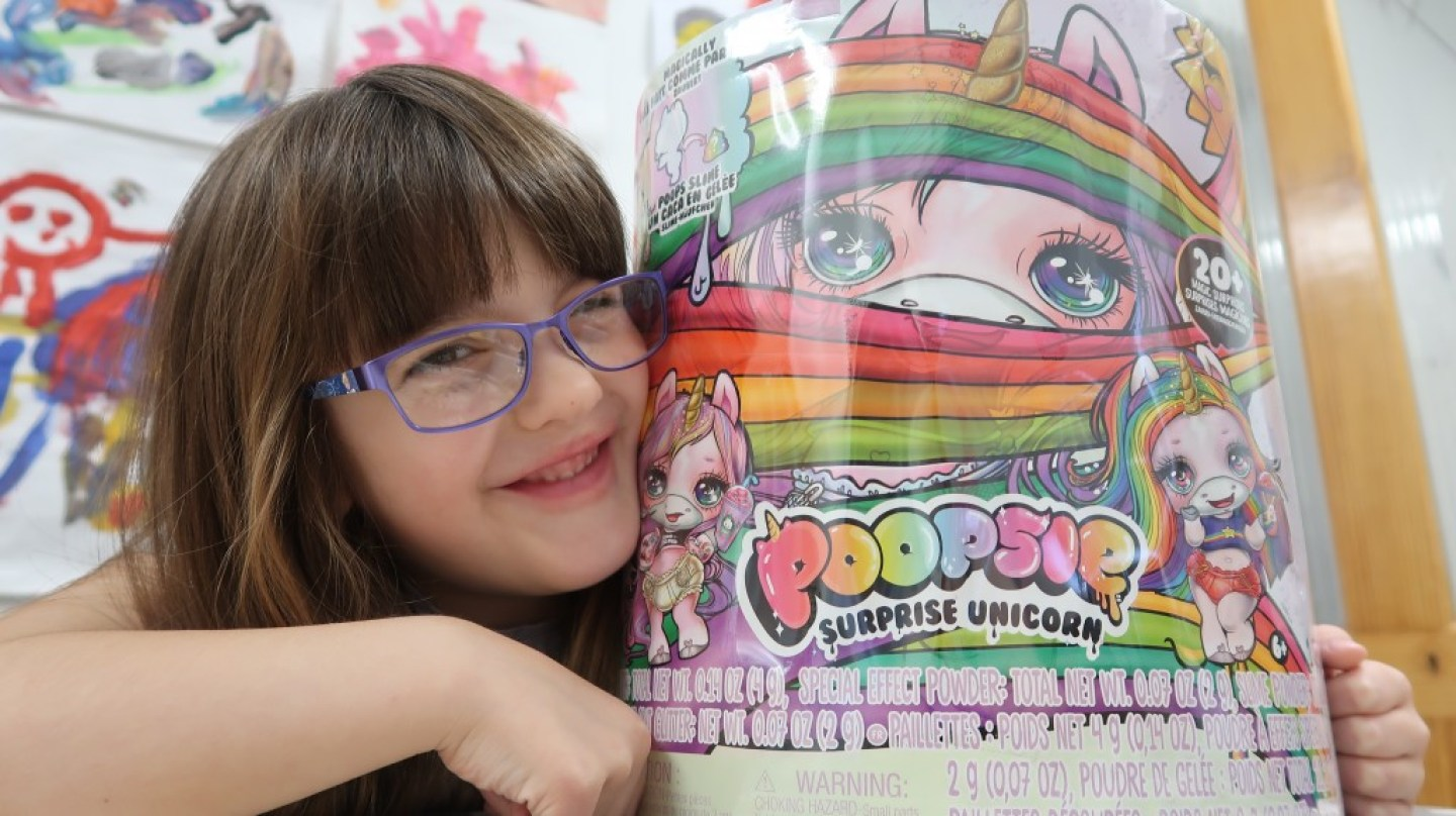 girl with Poopsie Surprise Unicorn
