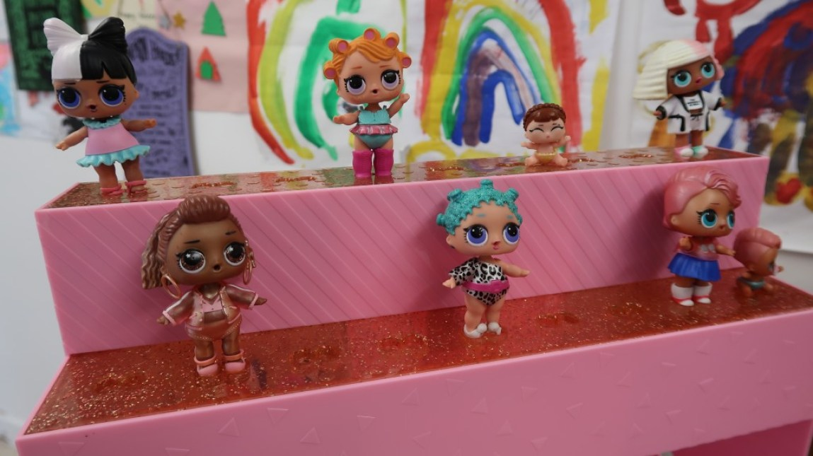 L.O.L Surprise! dolls on display stand
