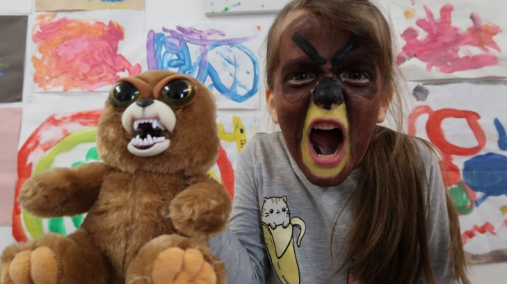 young girl face paint like a feisty pet