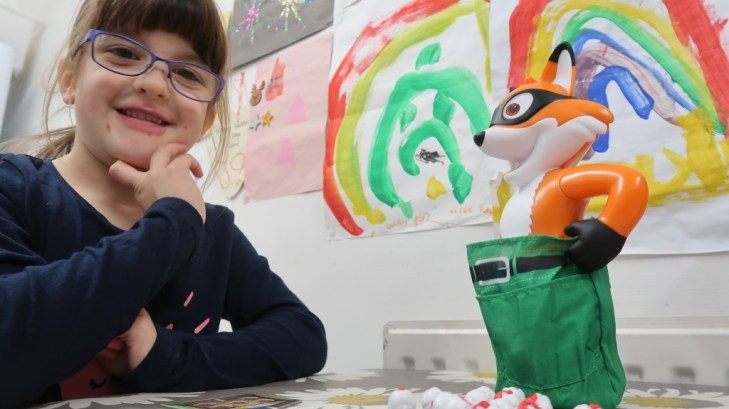 smiling girl in glasses with mr foxy pants