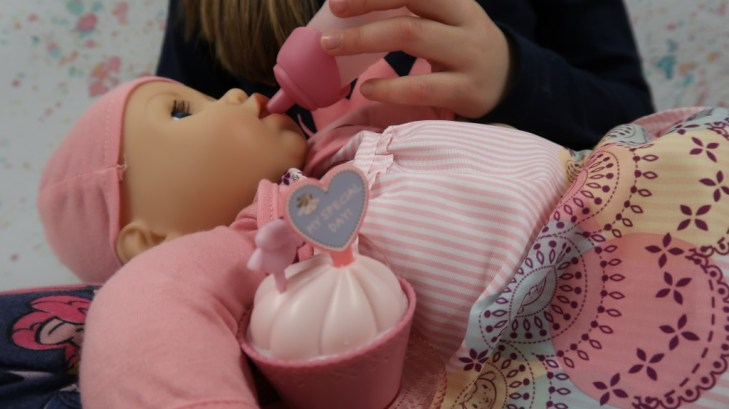 girl bottle feeding baby annabell my special day doll