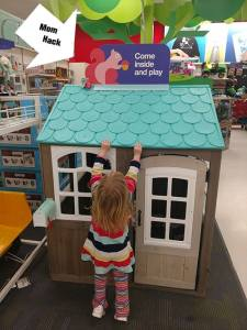 Playing at Target in our Mall. Mom hack. Stuffed toy on playhouse roof. Surviving Husband's Germs