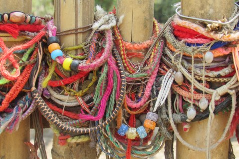 Bracelets laid in remembrance at one of the mass graves in the Killing Fields