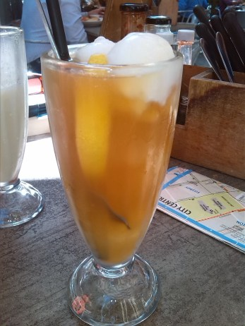 Homemade Ice Tea with lemon sorbet on top. Yes please!