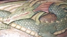 The Green Dragon carved above the bar
