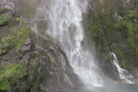 majestic waterfalls teem down the sides of the mountains