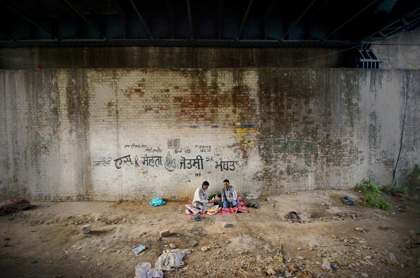 My bright and finished piece of Digital Photographic Art - a picnic under a bridge and next to the train tracks in Amritsar