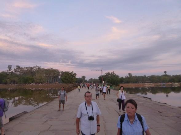 Walking across the bridge over the moat