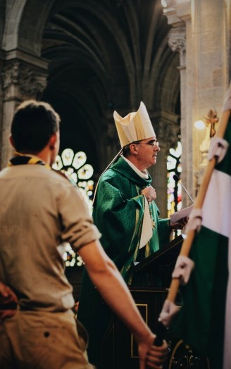 photo of priest standing on cathedral