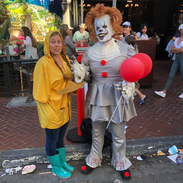 Georgie and Pennywise cosplayers