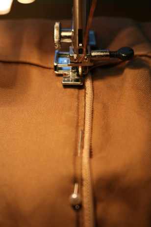 Make sure the zipper foot is on the correct side for the zipper side you are sewing. Your sewing machine manual should have instructions for this.