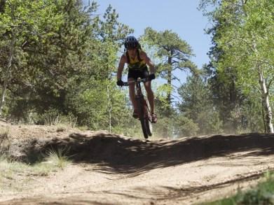 Mountain biking down a hill