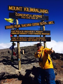 Richard Huang at the Summit of Mt. Kilimanjaro