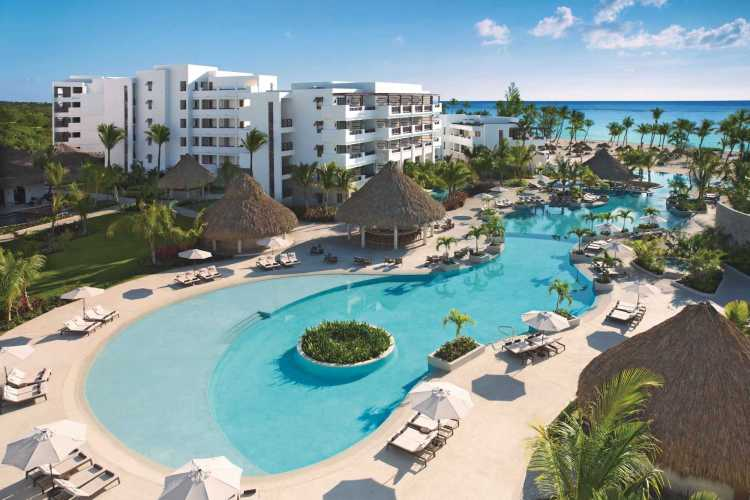 Beautiful pool and beach views from the all inclusive Secrets Cap Cana resort in Punta Cana