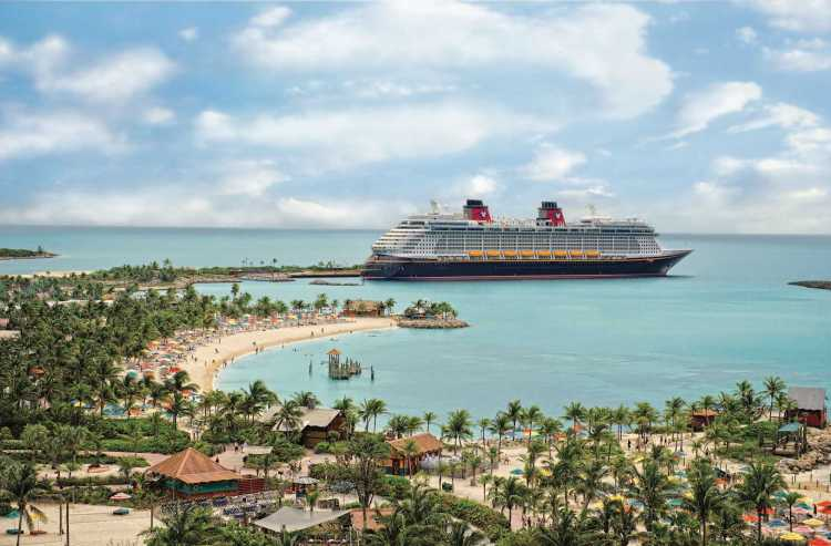 Cruise vacation fun at Disney's private island Castaway Cay with the Disney Fantasy ship in port