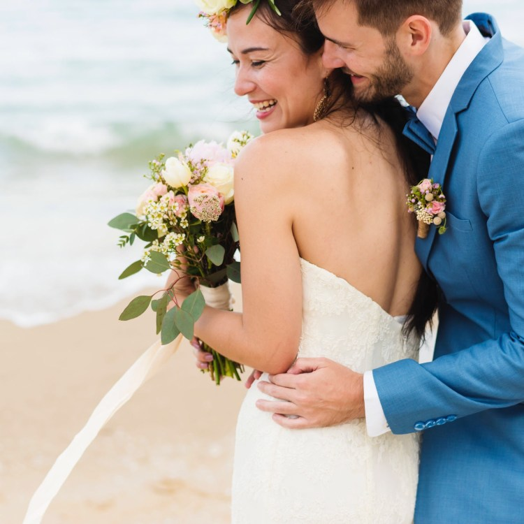 Destination wedding bride and groom embracing on a Caribbean beach