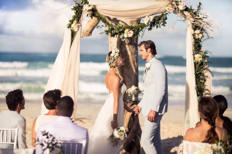 Destination wedding on the beach with Driftwood decor at an all inclusive Hard Rock Hotel in Mexico