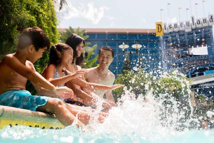 Family pool fun at the Disneyland Hotel at the Disneyland Resort in Anaheim, California