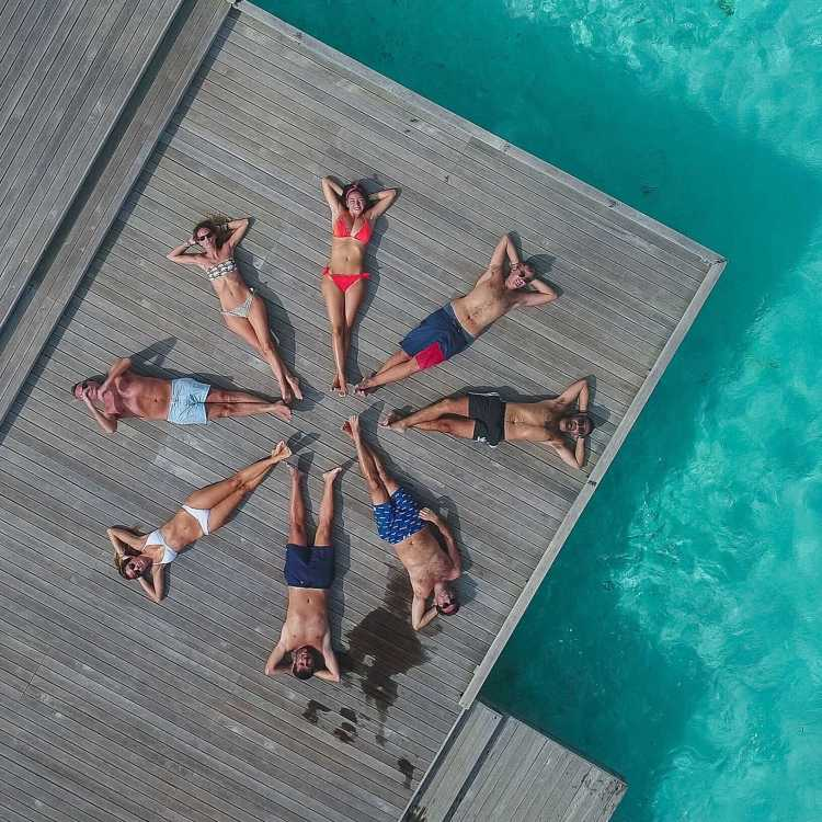 Group of friends on vacation, laying in the sun at a Caribbean resort