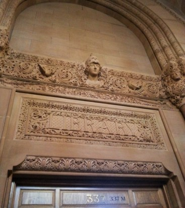 A close-up of the carvings about the entrance to the Library within the Capitol Building.