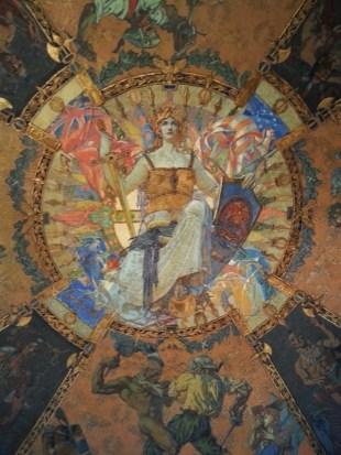 "This is the centerpiece of the War Room Murals located on the 2nd Floor. They were painted in the 1920's by William de Leftrich Dodge. His daughter, Sarah, was used as the model for the ""Goddess of Harmony"" or ""Spirit of New York,"" which is what is shown here. The tour guide called her ""Liberty."""
