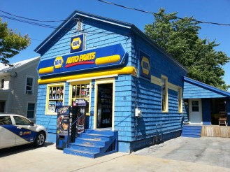 A Napa Auto Parts store that is clad entirely of shingles. It's a fun example of a shingle-style building that is not a home. This building is located on James Street in Clayton, NY.