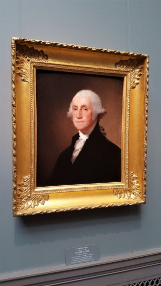 This is that famous painting of George Washington painted by Gilbert Stuart. It dates to c. 1821.