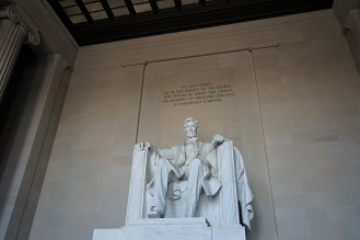 This is the statue of Abraham Lincoln. The design for the statue was created by Daniel Chester French. The statue was carved out of 28 blocks of white Georgia marble by the Piccirilli Brothers and French.