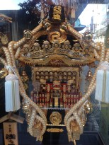 I think this is a mikoshi, used to transport a deity between shrines during festivals.