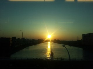 setting sun over a river in the north of tokyo