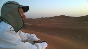 Mitch contemplating the Erg Chigaga desert in Sahara Morocco
