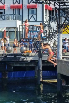 Girls jumping into water at Wellington Harbour waterfront