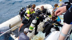 Loading dinghy with divers